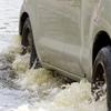 car driving through water_214773940 -